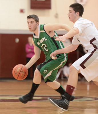 Pen Argyl #32 Austin Bender is defended by Bangor #52 Alex Colton in their boys basketball game held at Bangor High School on Thursday.