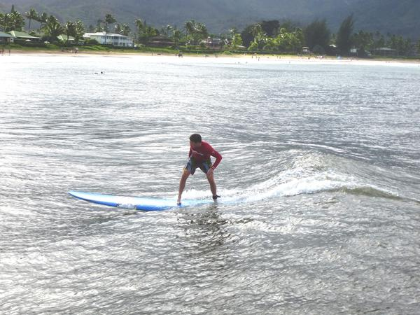 "Hanalei Bay's gentle waves are ideal for beginning surfers, while Mom and Dad can walk the beach and check out the sights, just as George Clooney did in ""The Descendants."" You might even go into town for a cold one at Tahiti Nui, the bar featured in the movie. Or maybe just some shave ice."
