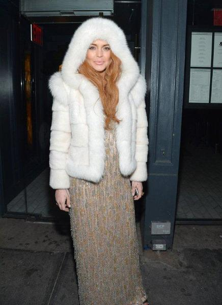 Lindsay Lohan looks ready for Winter Storm Nemo to hit as she poses in a fur hoodie at the AmFar Gala after-party in New York on Wednesday.