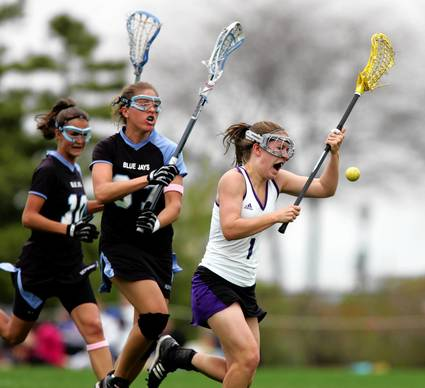 Northwestern's Hilary Bowen chases the ball against Johns Hopkins' Kelly Put