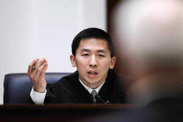 "Speaking for the California Supreme Court in the worker bias cases, Justice Goodwin Liu, shown in a separate case in 2012, said, ""There is no question that an employment decision motivated in substantial part by discrimination inflicts dignitary harm on the affected individual, even if the employer would have made the same decision in the absence of discrimination."""