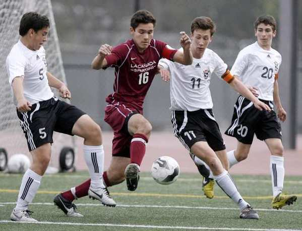 La Canada's Aidan Tourani, #16, battles for the ball with, from left, South Pasadena's Oscar Jaime, Charlie Slocum and Zack Dunn.