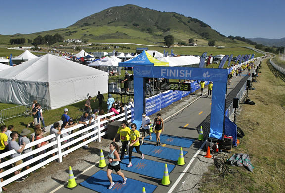 Runners cross the finish line at last year's 5K race, held at the Madonna Inn in San Luis Obispo.