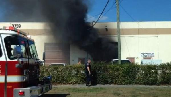 Two burning vehicles damaged an auto repair warehouse in Lauderhill but there were no reports of any injuries