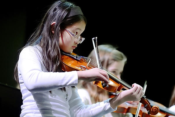 Emily Everett, a fifth-grader at Old Forge Elementary School, plays the violin on Thursday during the Elementary Arts Festival at South Hagerstown High School.