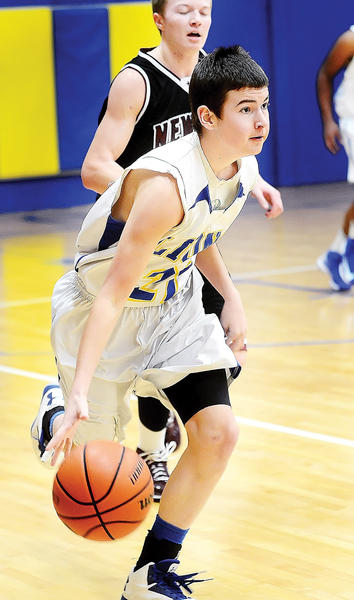 Broadfording's Matt Cradduck dribbles the ball upcourt during Thursday night's game against New Life Christian.
