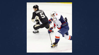 Washington Capitals' Alex Ovechkin (8) shoots behind Pittsburgh Penguins' Deryk Engelland (5) during the first period of an NHL hockey game Thursday in Pittsburgh.