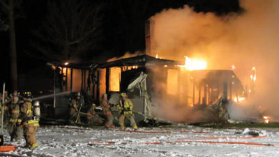 Volunteer firefighters from Sipesville and surrounding communities battle a house fire early Friday morning along Emert Road near Quecreek in Lincoln Township.