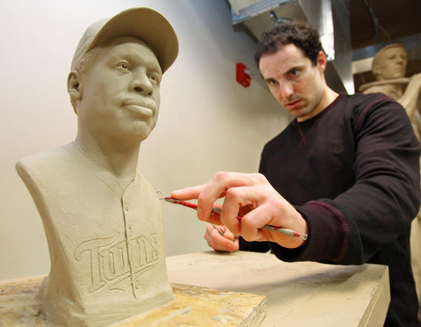 Sculptor Ben Victor cleans up a clay molding of baseball player Dave Winfield that will be signed by both Victor and Winfield when he visits Aberdeen Friday. Victor said the piece, which will be auctioned off for the Aberdeen Boys and Girls Club, will then be bronzed. photo by john davis taken 2/6/2013