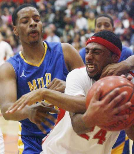 Pasadena's Andre Spight fights for the ball with Muir's Taturs Maberry. Spight scored 17 points for the Bulldogs.