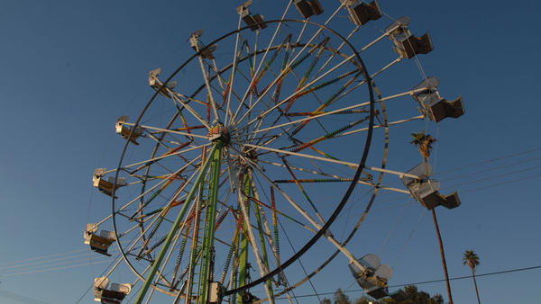 A Ferris wheel sits on the midway of the 2012 Carrot Carnival.