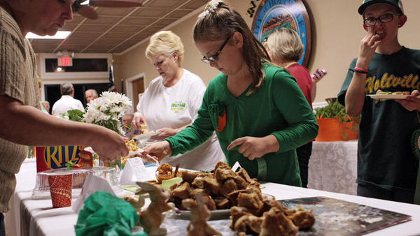 Guests take food samples after judges had announced the winning entries in the Little Chef and Junior Chef's Miscellaneous and Main Dish categories during the Carrot Festival Cookery Contest on Monday at Holtville Civic Center.