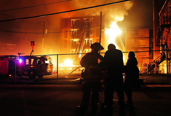 Flames shoot through a five-story building at 21 W. Antietam St. in Hagerstown early Friday morning. The vacant building caught fire late Thursday night.