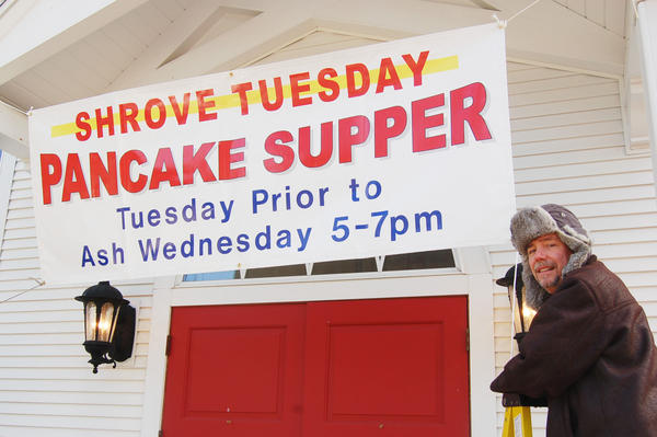 John Fiedorek puts up the pancake supper banner for the Shrove Tuesday pancake supper at Christ Episcopal Church in Charlevoix. The dinner, put on by the men of Christ Episcopal Church, will be served from 5-7 p.m. Tuesday, Feb. 12, at the church. Christ Episcopal Church was founded in 1894 and the men's pancake supper on Shrove Tuesday is a tradition that goes back many decades. Christ Episcopal Church is located on the corner of State and Clinton streets, one block west of the main downtown park in Charlevoix. All are welcome.