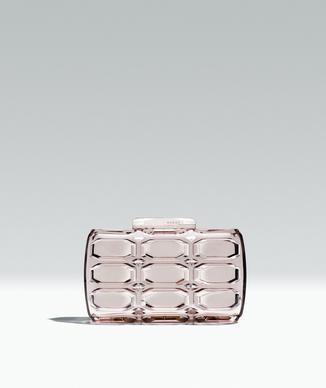 "How about a game of peek-a-boo? A sheer clutch handbag is a clear gift choice, given all the transparent accessories that are in stores for spring. Bonus: It forces you to downsize and get organized or your hot mess will be on view for all the world to see. (Gucci plexiglass clutch in Begonia Pink, $1,150 at Gucci, 347 N. Rodeo Drive, Beverly Hills, or <a href=""http://www.gucci.com"">gucci.com</a>)"