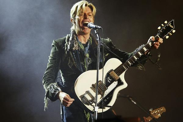 Bowie on stage on the third and final day of the Nokia Isle of Wight Festival 2004 at Seaclose Park, on June 13, 2004, in Newport, U.K.
