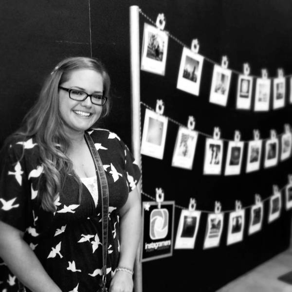 Ashley Turner (@DowntownFTL) poses in front of the Instagramers Fort Lauderdale show at Revel on the Block.
