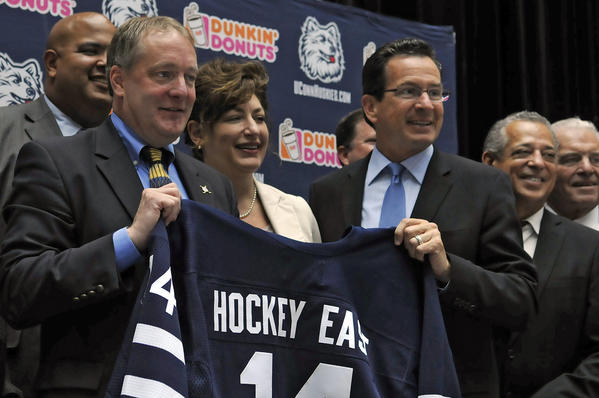 Bruce Marshall, holding a jersey with UConn President Susan Herbst and Gov. Dannel Malloy, was all smiles on June 29.