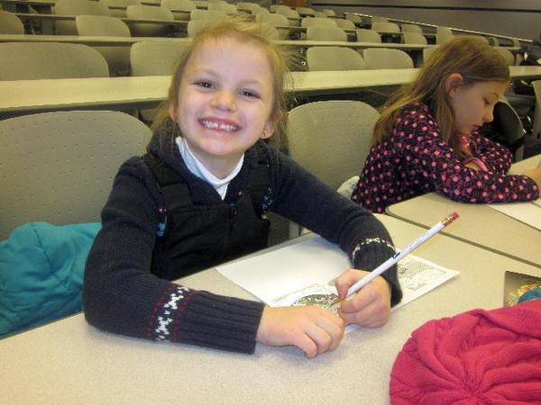 Sheridan Elementary School students Kaia Thompson (left) and Ella Grubaugh write in the speech bubbles on their empty comic strip at a Mind Zap event at North Central Michigan College.