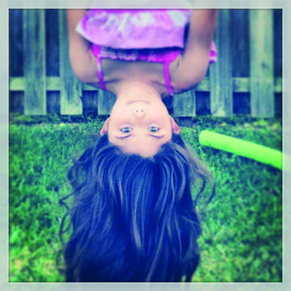 "Cooper City resident Aaron Wilson loves photographing his seven-year-old daughter Hannah. ""She loves playing on the swing set. She's in gymnastic classes and always practices on the swing bar, flipping around,"" said Wilson."