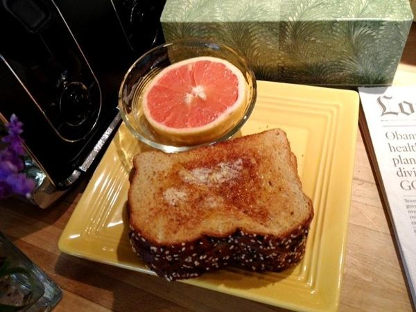 Breakfast for the puny includes toast with lots of butter and honey and grapefruit.