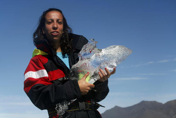 A local guide holds a 5,000-year-old piece of ice in Jokulsarlon Lagoon in southeast Iceland.