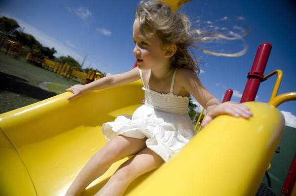 A young girl gets ready to slide at a Fort Lauderdale park.