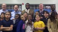 Bennett, Aaron's reps and the kids from the Boys & Girls Club