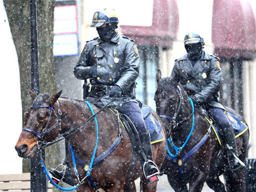 Bethlehem police officers patrol Main Street in the snow Friday. At left is Officer Tim Brooks who is riding Raven and at right is Officer Jon Buskirk who is riding Pharoah.