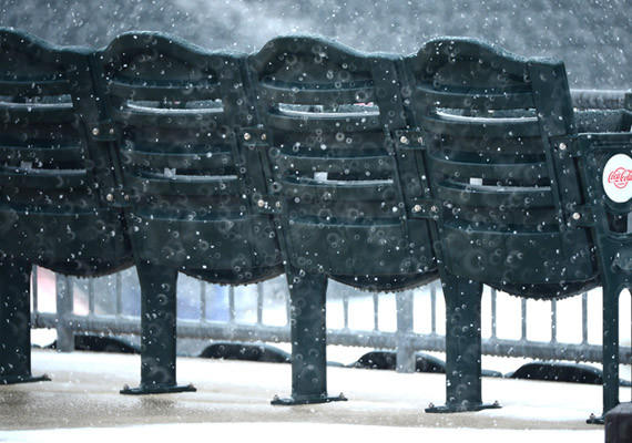 Seats at Coca Cola Park get wet in the snow Friday.