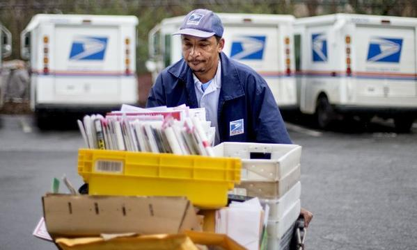 What my stuffed mailbox looks like. In reality, none of this was headed to Los Angeles. U.S. Postal Service letter carrier Michael McDonald prepares for his delivery run in Atlanta.