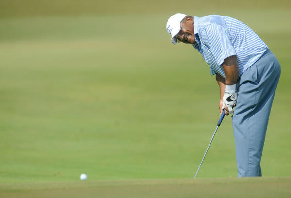 Jim Thorpe watches as his putt on the sixth green goes long during the opening round of the 2013 Allianz Championship in Boca Raton Friday.