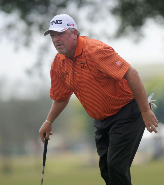 Mark Calcavecchia watches his putt find the hole on the first  green during the opening round of the 2013 Allianz Championship in Boca Raton Friday.