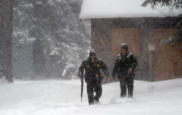 San Bernardino County sheriff's deputies battle the cold Friday during the hunt for murder suspect Christopher Dorner.  In frigid conditions, life-threatening hypothermia can strike in less than an hour.