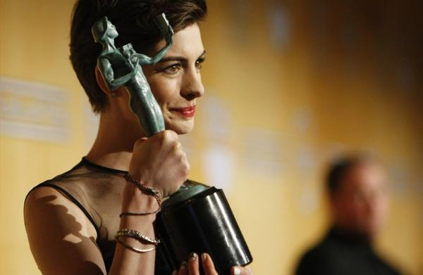 "Anne Hathaway won the Screen Actors Guild Award last month for ""Les Miserables."" Next year, the awards ceremony is moving to an earlier date in January ."