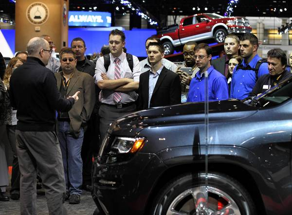 Attendees listen to the facts on the new 2014 Grand Cherokee SRT, at the 105th Chicago Auto Show held at McCormick Place in Chicago.
