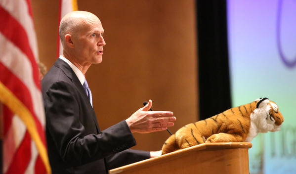 Gov. Rick Scott delivers remarks during his visit to the Tiger Bay Club of Orlando luncheon, in Orlando, Friday, February 8, 2013.   (Joe Burbank/Orlando Sentinel)    B582705830Z.1