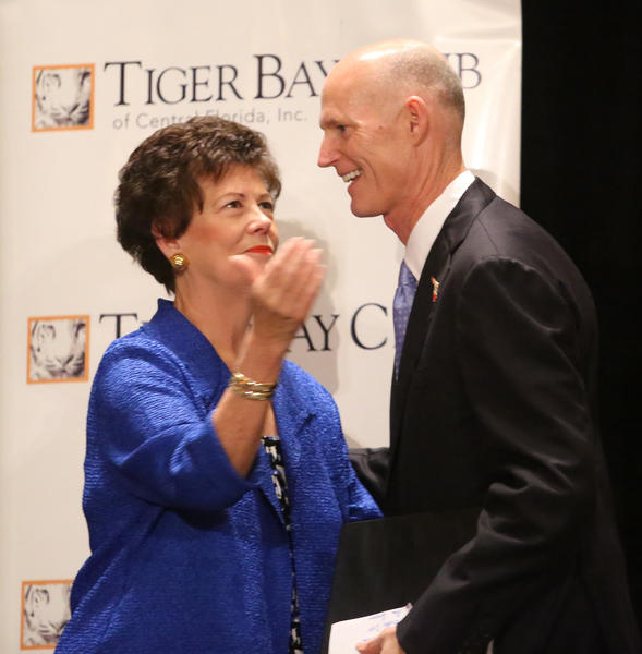 Gov. Rick Scott takes the stage after being introduced by former Lt. Gov. Toni Jennings during his visit to the Tiger Bay Club of Orlando luncheon, in Orlando, Friday, February 8, 2013.   (Joe Burbank/Orlando Sentinel)    B582705830Z.1