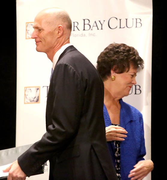 Gov. Rick Scott takes the stage after being introduced by former Lt. Gov. Toni Jennings during his visit to the Tiger Bay Club of Orlando luncheon, in Orlando, Friday, February 8, 2013.
