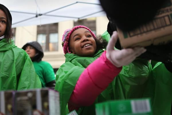 The Girl Scouts should stop trying to portray their Mango Creme cookies as a health food, say leaders of the Center for Science in the Public Interest. Above, Girl Scout cookies were selling briskly at stands set up in Midtown Manhattan on Friday as residents stocked up on vital supplies in anticipation of a punishing winter storm.