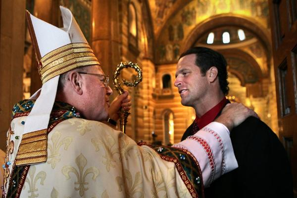Cardinal Timothy Dolan greets St. Louis Cardinals manager Mike Matheny after the funeral Mass for Stan Musial.