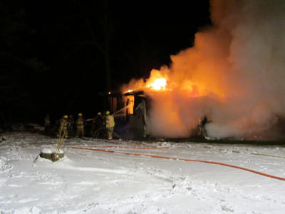 Volunteer firefighters from Sipesville and surrounding communities battle a house fire early Friday morning along Emert Road near Quecreek in Lincoln Township