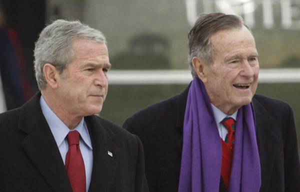Former presidents George W. Bush, left, and George H.W. Bush