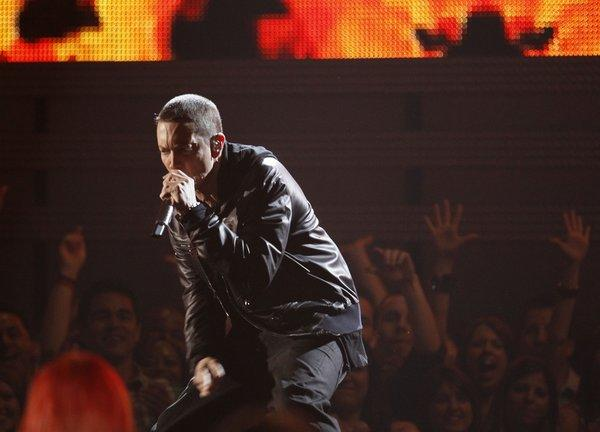 Rapper Eminem, shown performing during the 2011 Grammy Awards show, is expected to release his eighth album sometime after Memorial Day.