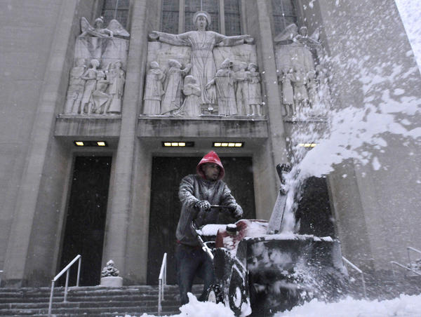Jose Cruz of Hartford was part of a team of employees from Errico Brothers Landscaping (of West Hartford) clearing the snow in front of Cathedral of St. Joseph in Hartford Friday afternoon.
