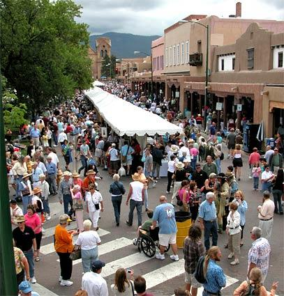 New Mexico's Santa Fe Plaza area is packed with booths and people during the event.