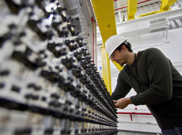 Manuel Lara, a phD student at Indiana University, arranges detector modules inside Hall D of the Continuous Electron Beam Accelerator Facility at Jefferson Lab on Thursday. The newly-constructed hall is part of Jefferson Lab's $310 million upgrade and will be the site of photon research.