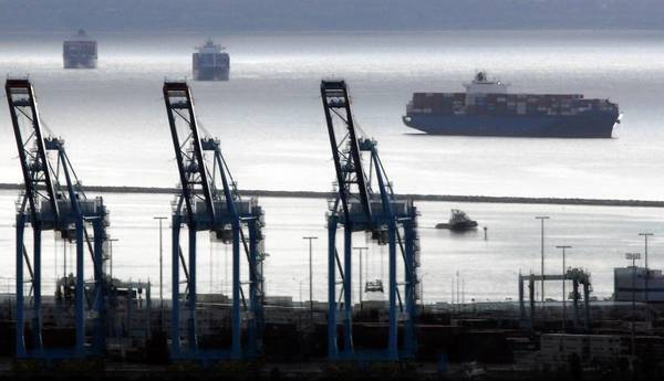 Bargaining units for the International Longshore and Warehouse Union Local 63 Office Clerical Unit rejected a tentative labor agreement this week that had ended an eight-day strike late last year. Above, container ships lie offshore near idled cranes at the port of Los Angeles.