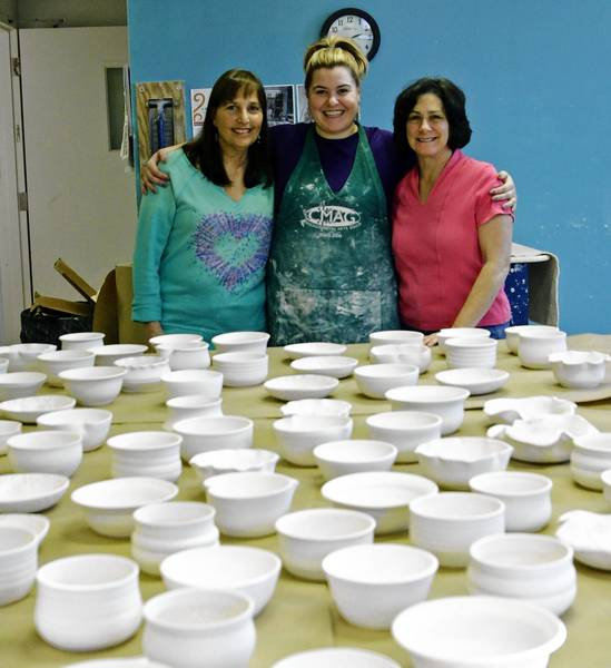 Ceramics teachers at The Art Center-Highland Park, from left, are Jill Hurwitz, Natalie Steinmetz and Debbie Sampson, with some of the bowls they are creating for a charity fundraising event at Whole Foods in Deerfield.