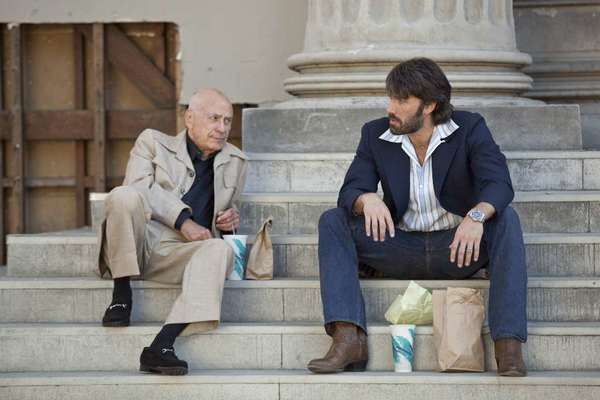 """Argo,"" starring Alan Arkin, left, and Ben Affleck, won the Scripter Award for writing"